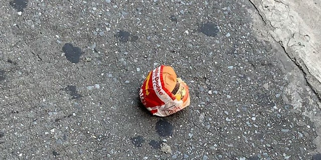 The burger was found on a street in Jamaica, Queens — which is approximately 1,500 miles away from the nearest In-N-Out.