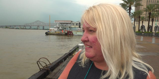 New Orleans resident Jena Smith looks out at the Mississippi River Wednesday. (Fox News/ Charles Watson)