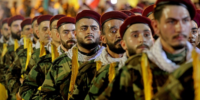 31 May 2019, Lebanon, Beirut: Pro-Iranian Hezbollah fighter take part in a parade to mark the annual al-Quds Day (Jerusalem Day) on the last Friday of the Muslim holy month of Ramadan.