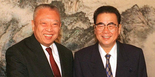 In this Dec. 10, 1997, file photo released by CHina's Xinhua News Agency, then Hong Kong leader Tung Chee-hwa and then Chinese Premier Li Peng shake hands at the start of their meeting in Beijing. Li Peng, a former hard-line Chinese premier best known for announcing martial law during the 1989 Tiananmen Square pro-democracy protests, has died. He was 90. (Xinhua via AP, File)