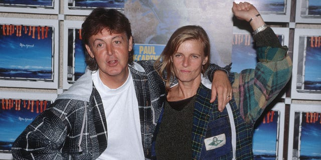 Paul McCartney and Linda McCartney posing at a photo shoot in the Olympic Stadium on September 3, 1993 in Berlin.