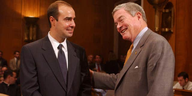 Eugene Scalia pictured in 2001 with then-Sen. Kit Bond, R-Mo. (Tom Williams/Roll Call/Getty Images, File)