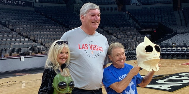 "Bill Laimbeer, center, coach of the WNBA's Las Vegas Aces basketball team, poses for photos with Kathy Coleman and Wesley Eure in Las Vegas last month. Laimbeer spent a season playing a Sleestak on ""Land of the Lost."""