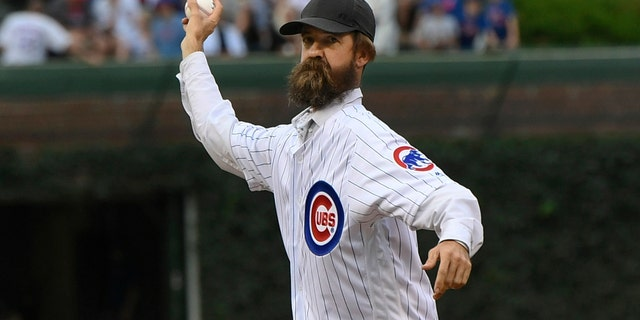Alligator trapper Frank Robb throws out a ceremonial first pitch before a baseball game between the Chicago Cubs and Cincinnati Reds on Tuesday, July 16, 2019 at Wrigley Field in Chicago. (AP Photo/Paul Beaty)