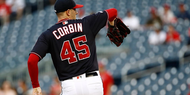 Washington Nationals starting pitcher Patrick Corbin warms up before a baseball game against the Miami Marlins, Tuesday, July 2, 2019, in Washington. Corbin wore number 45 in remembrance of Los Angeles Angels pitcher Tyler Skaggs, who was found dead on Monday. (AP Photo/Patrick Semansky)