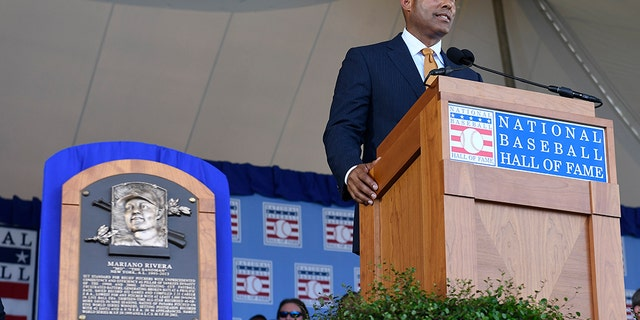 National Baseball Hall of Fame inductee Mariano Rivera, New York Yankees pitcher speaks during an induction ceremony at the Clark Sports Center on Sunday, July 21, 2019, in Cooperstown, N.Y. (AP Photo/Hans Pennink)