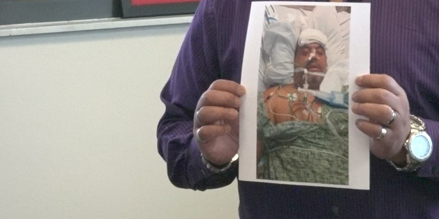 Martinez shows a design of himself after a puncture medicine during a hospital, after his liposuction procedure