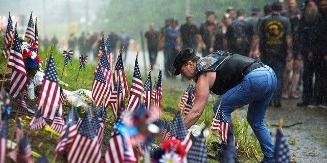 Bikers during a commemorative site where 7 bikers roving with a Jarheads Motorcycle Club were killed in a collision final month Saturday. (Paul Hayes/Caledonian-Record around AP)