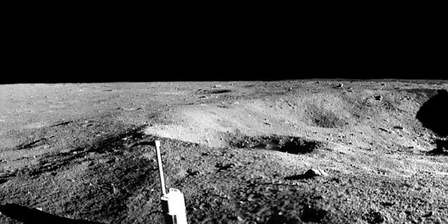 A panoramic view of Little West Crater, with the Eagle Lunar Module in the distance. This photograph was taken by Neil Armstrong.