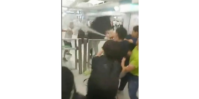 Protesters trying to return home in Hong Kong were attacked inside a train station by assailants who appeared to target the pro-democracy demonstrators.