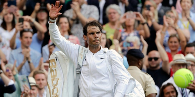 Rafael Nadal leaves the court after Friday's match. (AP Photo/Ben Curtis)