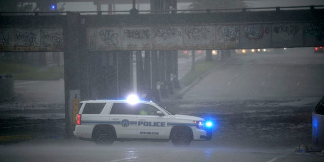 An NOPD cruiser blocks the underpass at S. Carrollton Ave. in New Orleans as severe thunderstorms caused street flooding, Wednesday, July 10, 2019.