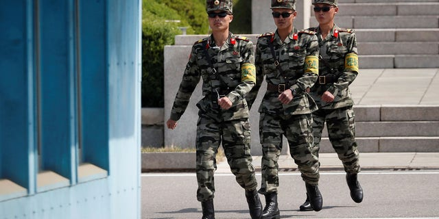 North Korean soldiers patrol at the truce village of Panmunjom inside the demilitarized zone separating the two Koreas, in May.