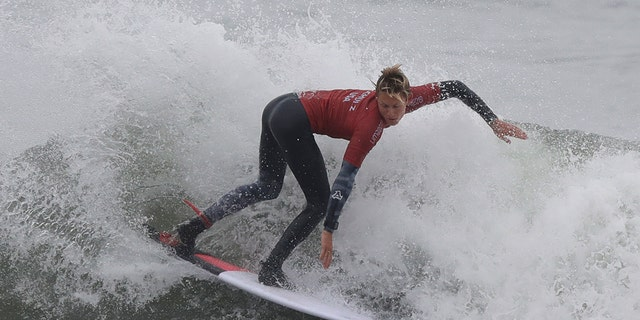 Kevin Schulz of the United States competes in the men's open surfing main round 1, during the Pan American Games on Punta Rocas beach in Lima Peru, Monday, July 29, 2019. (AP Photo/Silvia Izquierdo)