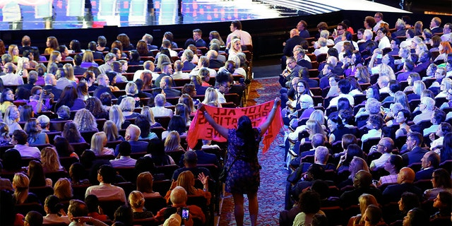 A protester yelling during the second CNN debate in Detroit. (AP Photo/Paul Sancya)