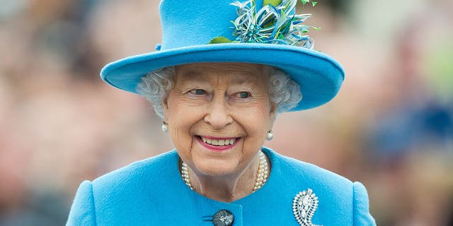 Queen Elizabeth II tours Queen Mother Square on October 27, 2016, in Poundbury, Dorset.