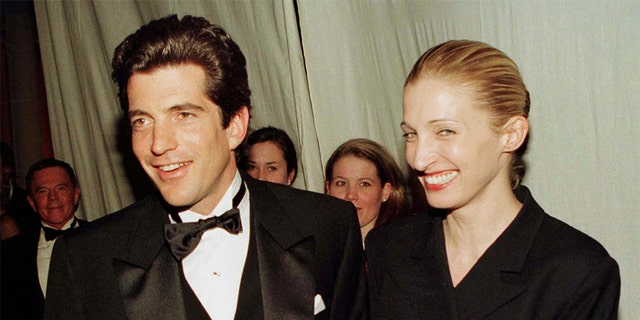 John F. Kennedy Jr. and his wife Carolyn Bessette stop for photographers after Kennedy presented actor Robert De Niro with the Municipal Art Society of New York's Jacqueline Kennedy Onassis Medal at a gala dinner in New York, March 4. De Niro was honored for his outstanding contribution to the preservation of New York City's neighborhoods.