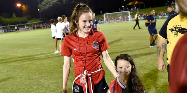 BOYDS, MD - JULY 20: Washington Spirit midfielder Rose Lavelle (10) poses for a photo with a young girl named Rose Lavelle after the National Womens Soccer League (NWSL) game between the Houston Dash and Washington Spirit July 20, 2019 at Maureen Hendricks Field at Maryland SoccerPlex in Boyds, MD. (Photo by Randy Litzinger/Icon Sportswire via Getty Images)