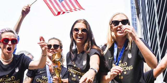 Alex Morgan (center) seen here with Megan Rapinoe, Ashlyn Harris and Allie Long, scored six goals during the tournament.