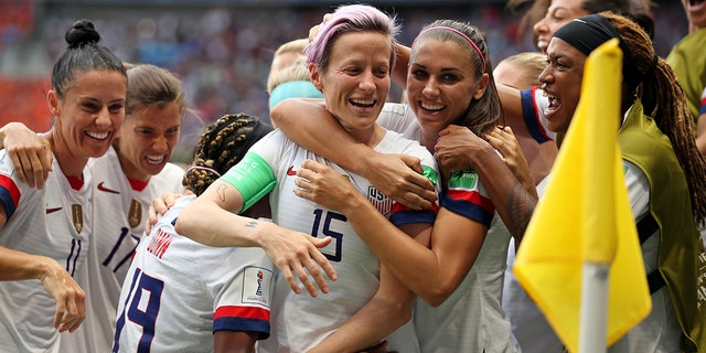 United States' Megan Rapinoe, center, celebrates after scoring the opening goal from the penalty spot during the Women's World Cup final soccer match between US and The Netherlands at the Stade de Lyon in Decines, outside Lyon, France, Sunday, July 7, 2019. (AP Photo/Francisco Seco)