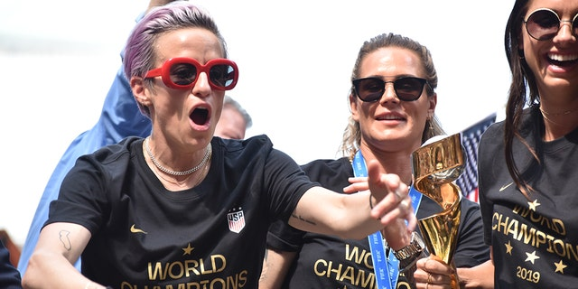 Megan Rapinoe celebrates with her teammates.