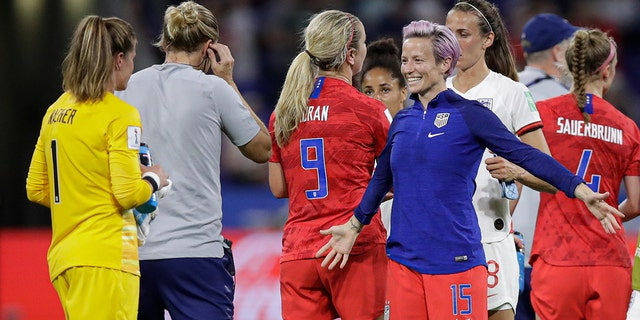 United States' Megan Rapinoe prepares to hug United States goalkeeper Alyssa Naeher after the Women's World Cup semifinal soccer match between England and the United States, at the Stade de Lyon, outside Lyon, France, Tuesday, July 2, 2019. (AP Photo/Alessandra Tarantino)