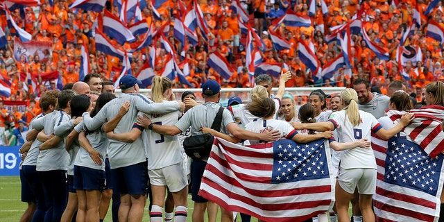 Members of a US group applaud during a finish of a Women's World Cup final soccer compare between US and The Netherlands during a Stade de Lyon in Decines, outward Lyon, France, Sunday, Jul 7, 2019. US won 2:0. (AP Photo/David Vincent)