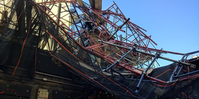 Fire officials said three people were hurt after scaffolding blew off the top of a 12-story building in Brooklyn. (New York City Fire Department)