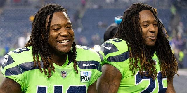 Seattle Seahawks brothers Shaquem Griffin (49) and Shaquill Griffin (26) walk off the field together during a game between the Minnesota Vikings and the Seattle Seahawks. (Photo by Christopher Mast/Icon Sportswire via Getty Images)