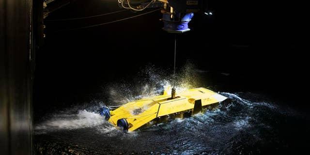 The undersea drone Surveyor Interceptor being deployed.