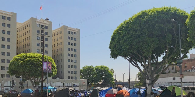 The tent encampment on San Pedro St. in Skid Row borders a parking lot that is slated to become a supportive housing complex with 298 residential units. (Andrew O'Reilly/Fox News)