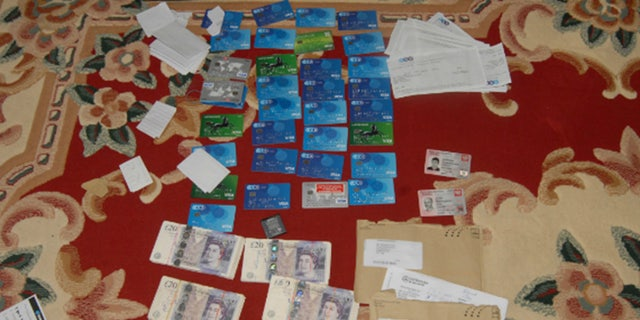 Credit and debit cards that were created in the victims' names and used by the gang members to steal their wages.