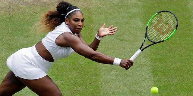 United States' Serena Williams earnings to United States' Alison Riske in a Women's quarterfinal singles compare on day 8 of a Wimbledon Tennis Championships in London, Tuesday, Jul 9, 2019. (AP Photo/Ben Curtis)