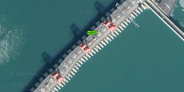 Google Maps image of the Three Gorges Dam, showing the evident warping on the structure.