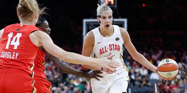 Washington Mystics' Elena Delle Donne, right, of Team Delle Donne, passes around Team Wilson during the first half of a WNBA All-Star basketball game Saturday, July 27, 2019, in Las Vegas. (AP Photo/John Locher)