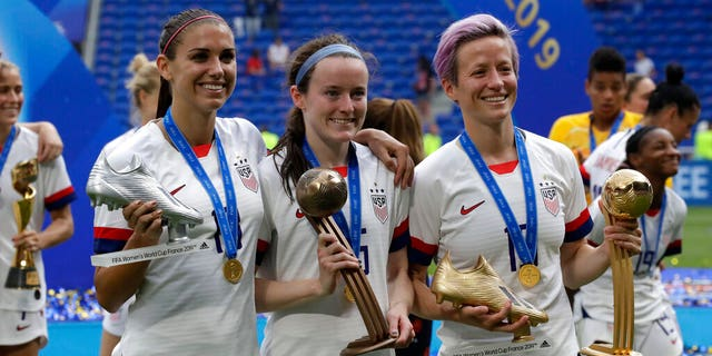 United States' Megan Rapinoe, right, United States' Alex Morgan, left, and United States' Rose Lavelle, center, poise with their trophies after a Women's World Cup final soccer compare between US and The Netherlands. (AP Photo/Alessandra Tarantino)