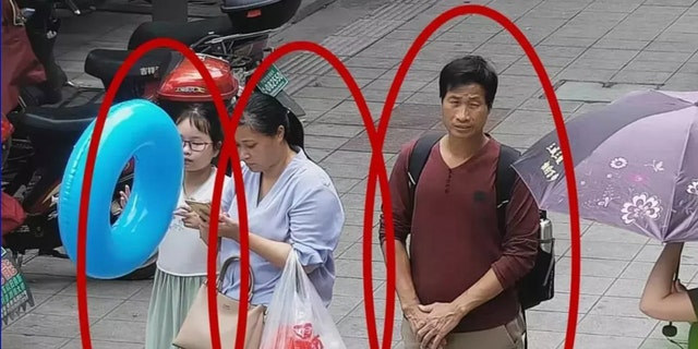 A photo shared by the Xiangshan police of Zhang with the couple.
