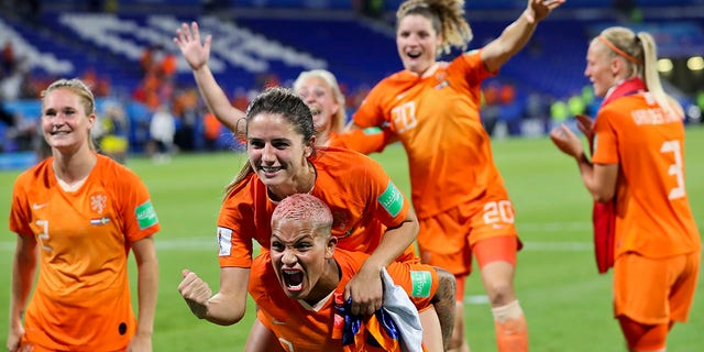 Dutch players celebrate after winning the Women's World Cup semifinal soccer match against Sweden at the Stade de Lyon outside Lyon, France, Wednesday, July 3, 2019. (Associated Press)