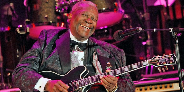 In this June 20, 2008 file photo, musician B.B. King performs at the opening night of the 87th season of the Hollywood Bowl in Los Angeles. Julien's Auctions announced Tuesday, July 23, 2019, that King's black Gibson ES-345 prototype guitar is among the items from his estate that will go up for bid on Sept. 21. Julien's says Gibson gave King the instrument for his 80th birthday.