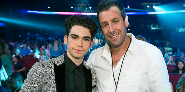 Cameron Boyce poses with Adam Sandler at the Radio Disney Music Awards 2017. Sandler, who played Boyce's father in