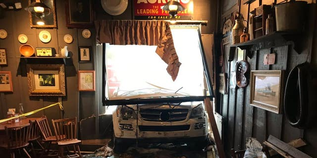 A white SUV crashed into a Cracker Barrel in Knoxville, Tenn., on Tuesday, deleterious a chain's dining room and window.