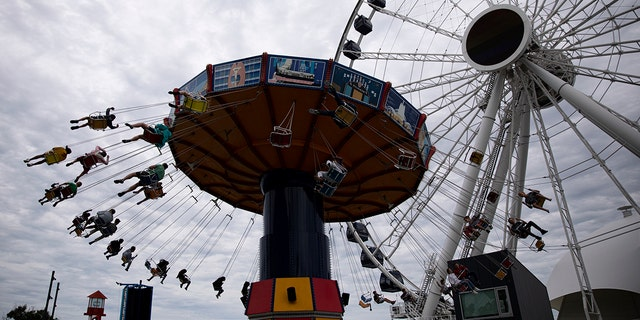 People ride a wave swinger at Chicago's Navy Pier, Friday, June 21, 2019. (Associated Press)
