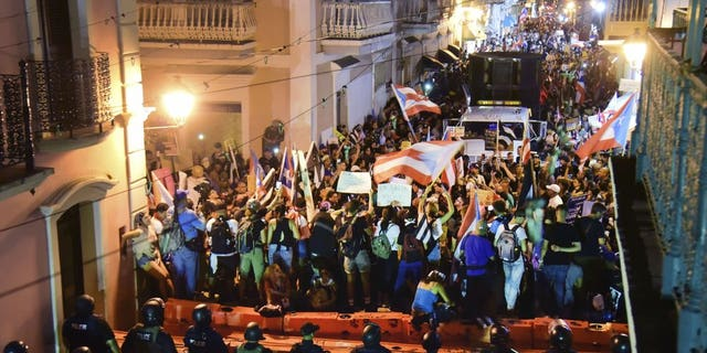 Demonstrators protest against governor Ricardo Rossello, in San Juan, Puerto Rico, Friday, July 19, 2019. Protesters are demanding Rossello step down for his involvement in a private chat in which he used profanities to describe an ex-New York City councilwoman and a federal control board overseeing the island's finance.