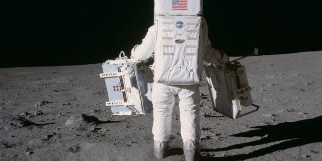 Astronaut Edwin (Buzz) Aldrin deploys two scientific experiments on the surface of the moon during Apollo 11.