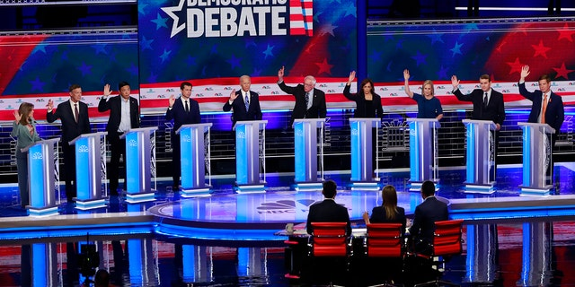 Candidates were asked to raise their hands if they would provide healthcare for undocumented immigrants during the Democratic primary debate hosted by NBC News last month. (AP Photo/Wilfredo Lee)