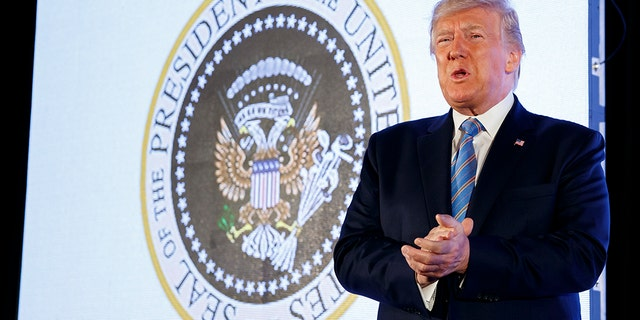 President Trump arrives to speak, with an altered presidential seal behind him, at Turning Point USA's Teen Student Action Summit 2019, Tuesday, July 23, 2019, in Washington. (AP Photo/Alex Brandon)