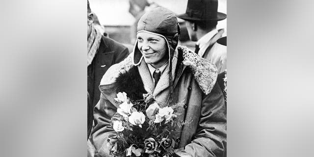 FILE - In this June 26, 1928, file photo, American aviatrix Amelia Earhart poses with flowers as she arrives in Southampton, England, (AP Photo, File)