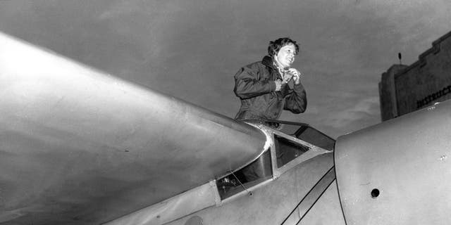 FILE - In this Jan. 13, 1935, file photo, American aviatrix Amelia Earhart climbs from the cockpit of her plane at Los Angeles, Calif., after a flight from Oakland to visit her mother.