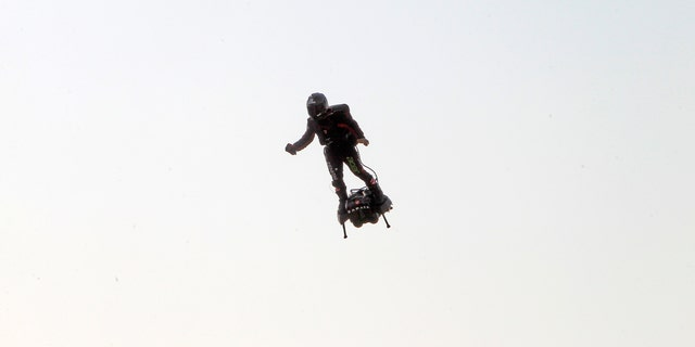 Zapata was anchored to his flyboard, a small flying platform he invented, taking off from Sangatte, in France's Pas de Calais region, and flying to the Dover area in southeast England. (AP Photo/Michel Spingler)