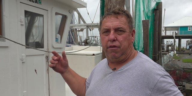 Floyd Lesseigne stands by his docked boat in Grand Isle, La. He estimates he left as much as $1,500 in profit at sea because Hurricane Barry put his business out of commission for several days. (Fox News/ Charles Watson)